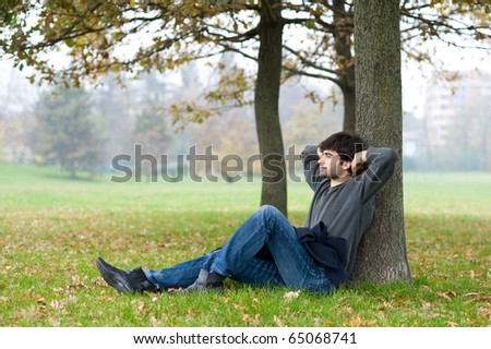 Relaxed man outdoor. - stock photo