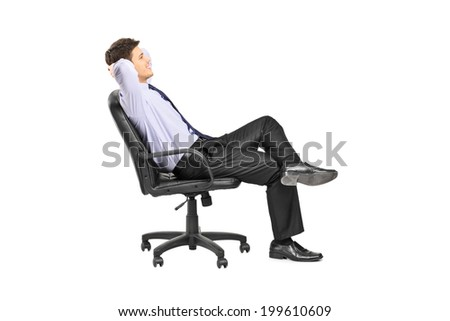 Relaxed man sitting in an office chair isolated on white background - stock photo