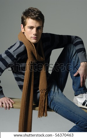 relaxed man sitting on posing shot in studio - stock photo