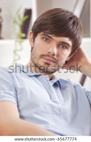 relaxed man sitting on the sofa at home