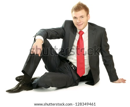 Relaxed mature business man sitting on the floor