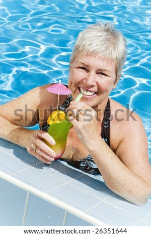 relaxed mature woman enjoying summer holidays - stock photo
