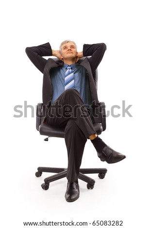 Relaxed middle aged business man seated on a chair isolated on white - stock photo