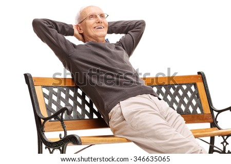 Relaxed senior gentleman sitting on a wooden bench and looking in the distance isolated on white background - stock photo