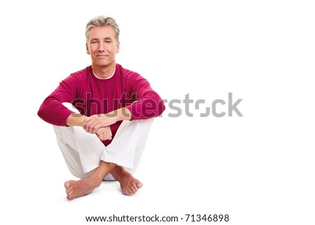 Relaxed senior man sitting in tailor seat on white - stock photo