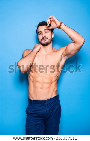 relaxed sexy man shirtless on blue background - stock photo