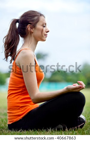 Relaxed thin woman practicing yoga at the park - stock photo