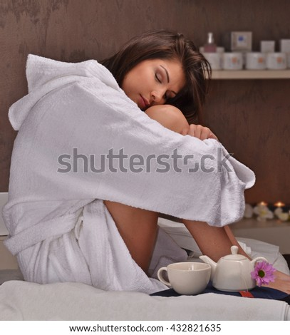Relaxed woman at beauty center after body treatment spa. - stock photo