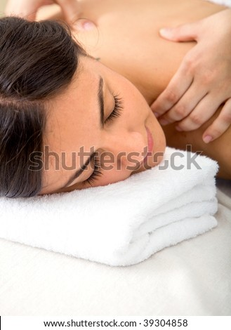 Relaxed woman getting a massage on her back