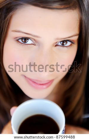 relaxed woman has a cup of tea at home