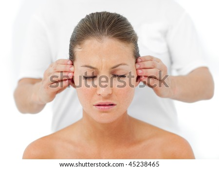 Relaxed woman having a head massage in a spa