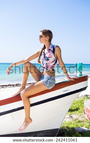 Relaxed woman in a Caribbean beach - stock photo