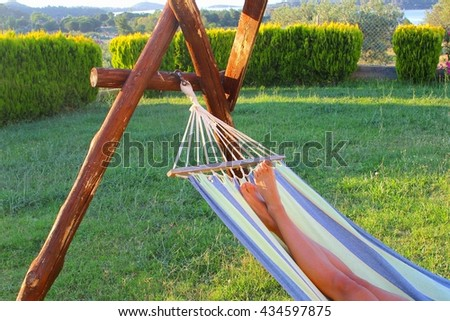 Relaxed woman in a hammock in nature