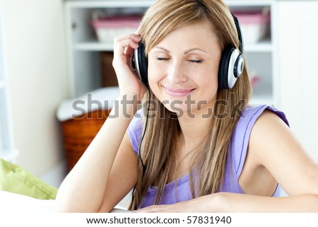 Relaxed woman listening to music at home - stock photo
