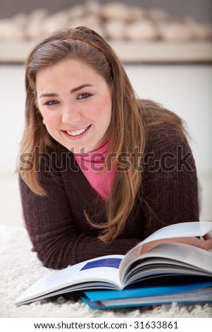 Relaxed woman lying on the floor studying