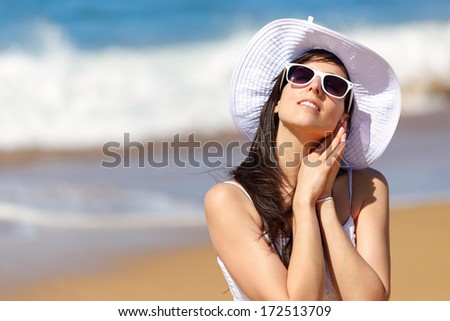 Relaxed woman on beach summer vacation. Girl enjoying freedom, leisure and relax listening the sea waves.