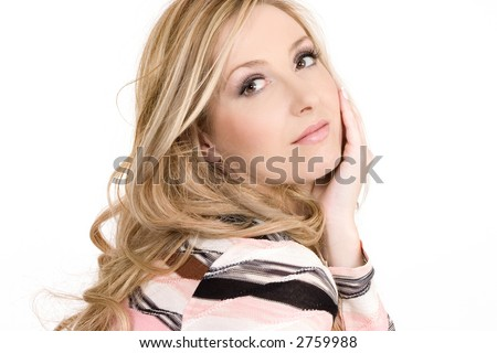 Relaxed woman sitting comfortably and thinking serene thoughts - stock photo
