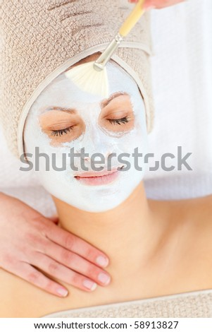 Relaxed woman with closed eyes having a massage in a spa