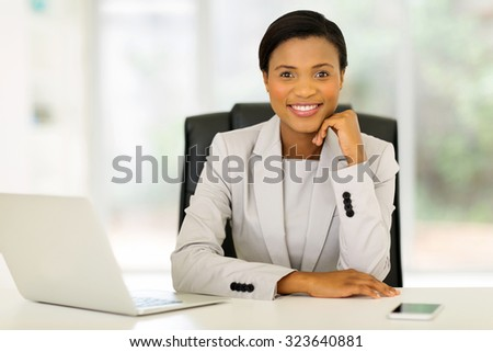 relaxed young african corporate worker sitting in office