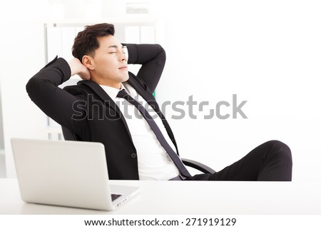 relaxed Young businessman  in the  office - stock photo