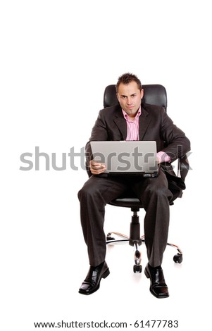 Relaxed young businessman, sitting on a chair with laptop. Isolated on white background.