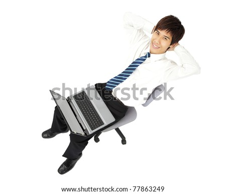 Relaxed young businessman with laptop - stock photo