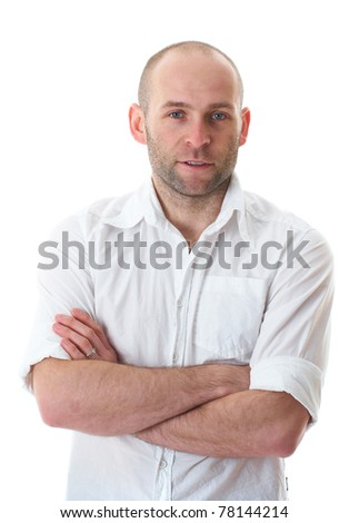 relaxed young guy in white shirt with hands crossed on his chest, isolated on white background - stock photo