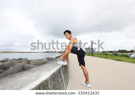 Relaxed young man by the sea