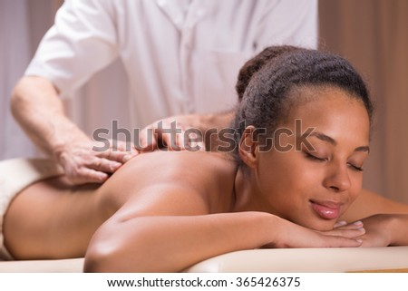 Relaxed young woman and regeneration on massage in spa - stock photo