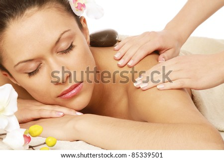 Relaxed young woman at spa salon - stock photo