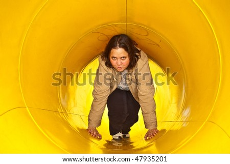 relaxed young woman in a yellow craw tube