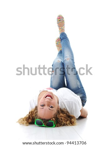 Relaxed young woman lying at home and having fun - stock photo