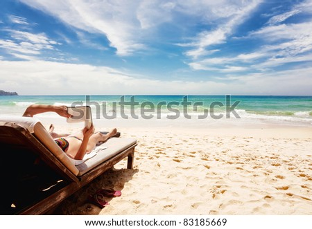 Relaxing and reading book at the beach . Thailand - stock photo