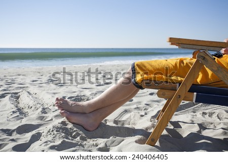 Relaxing at the Beach - stock photo