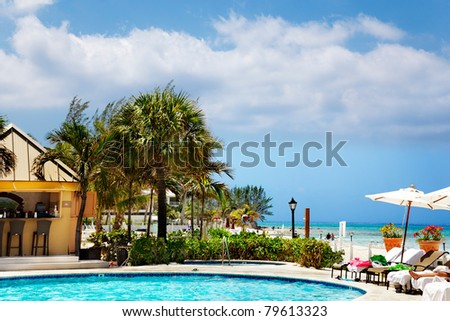 Relaxing at the beachside pool in a Caribbean resort - stock photo