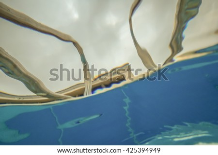 relaxing at the swimming pool - stock photo