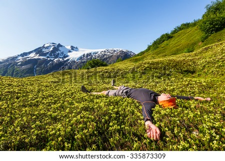 Relaxing backpacker in the mountains. - stock photo