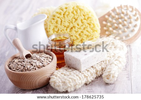 relaxing bath with oat soap honey and milk - beauty treatment - stock photo
