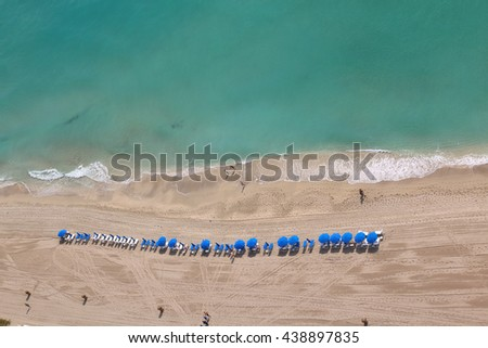 Relaxing beach chairs and umbrellas over a beach shore. Relaxing resort  - stock photo
