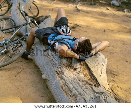 Relaxing bicyclist in forest