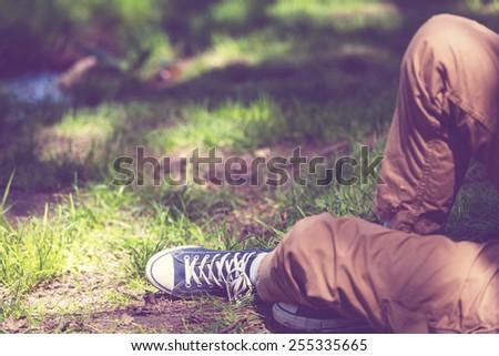 Relaxing boy in a meadow - stock photo