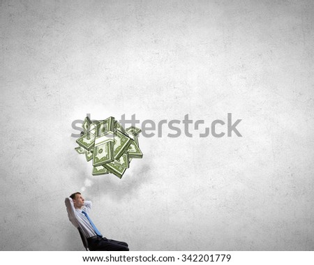 Relaxing businessman sitting in chair with hands on head