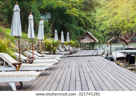 Relaxing chairs beside the River Kwai in Thailand.