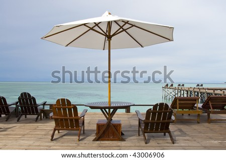 Relaxing Chairs with Umbrella at the beach