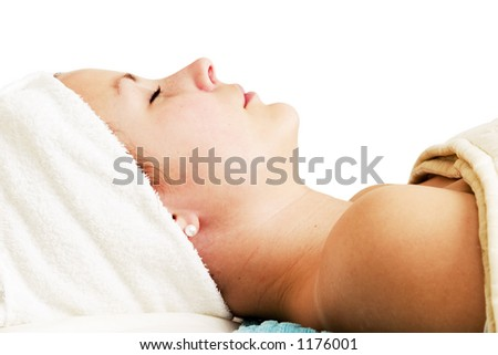 Relaxing during a facial treatment at a beauty spa.