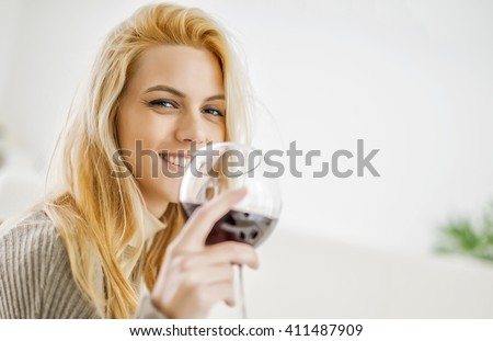 Relaxing evening with a glass of wine - stock photo