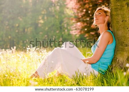 Relaxing female enjoying summer day - stock photo