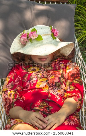 Relaxing girl on hammock. Relaxing girl. - stock photo