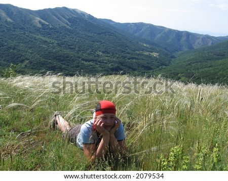 Relaxing girl  on the grassland