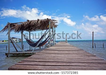Relaxing Hammock on the Dock                       - stock photo